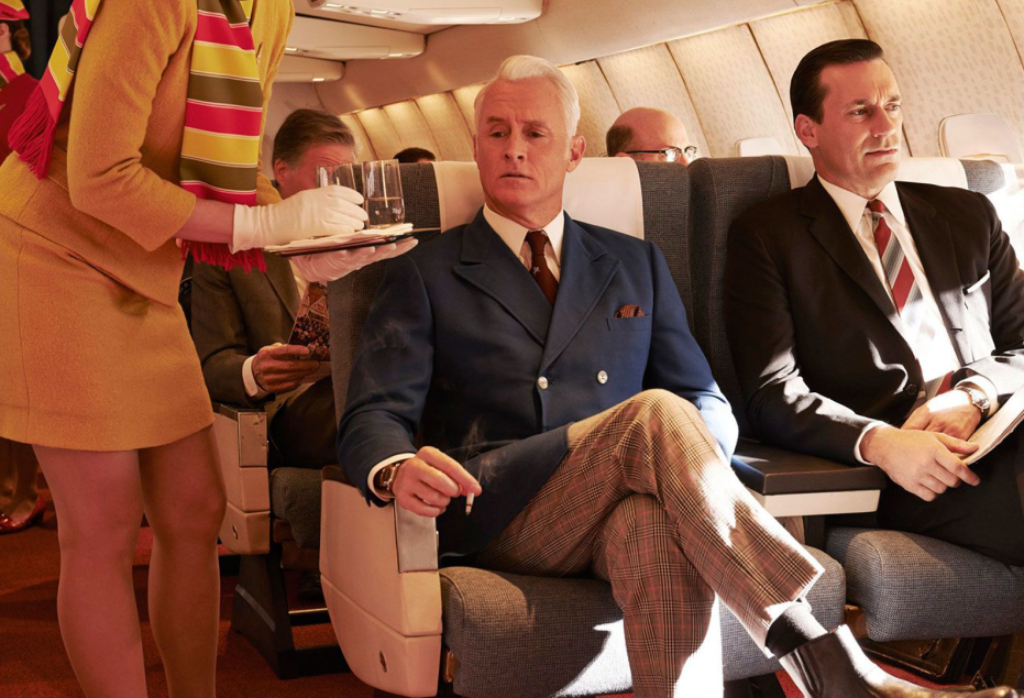 Roger Sterling and Don Draper on an airplain